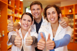 pharmacist showing their thumbs up